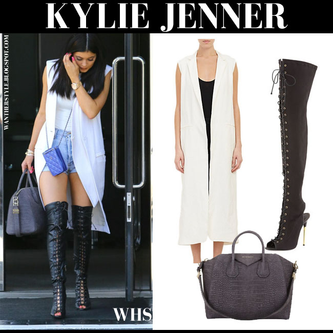 Kylie Jenner in white sleeveless long Nomia vest, black lace-up over the knee Tom Ford boots with grey Givenchy Antigona duffel what she wore may 30