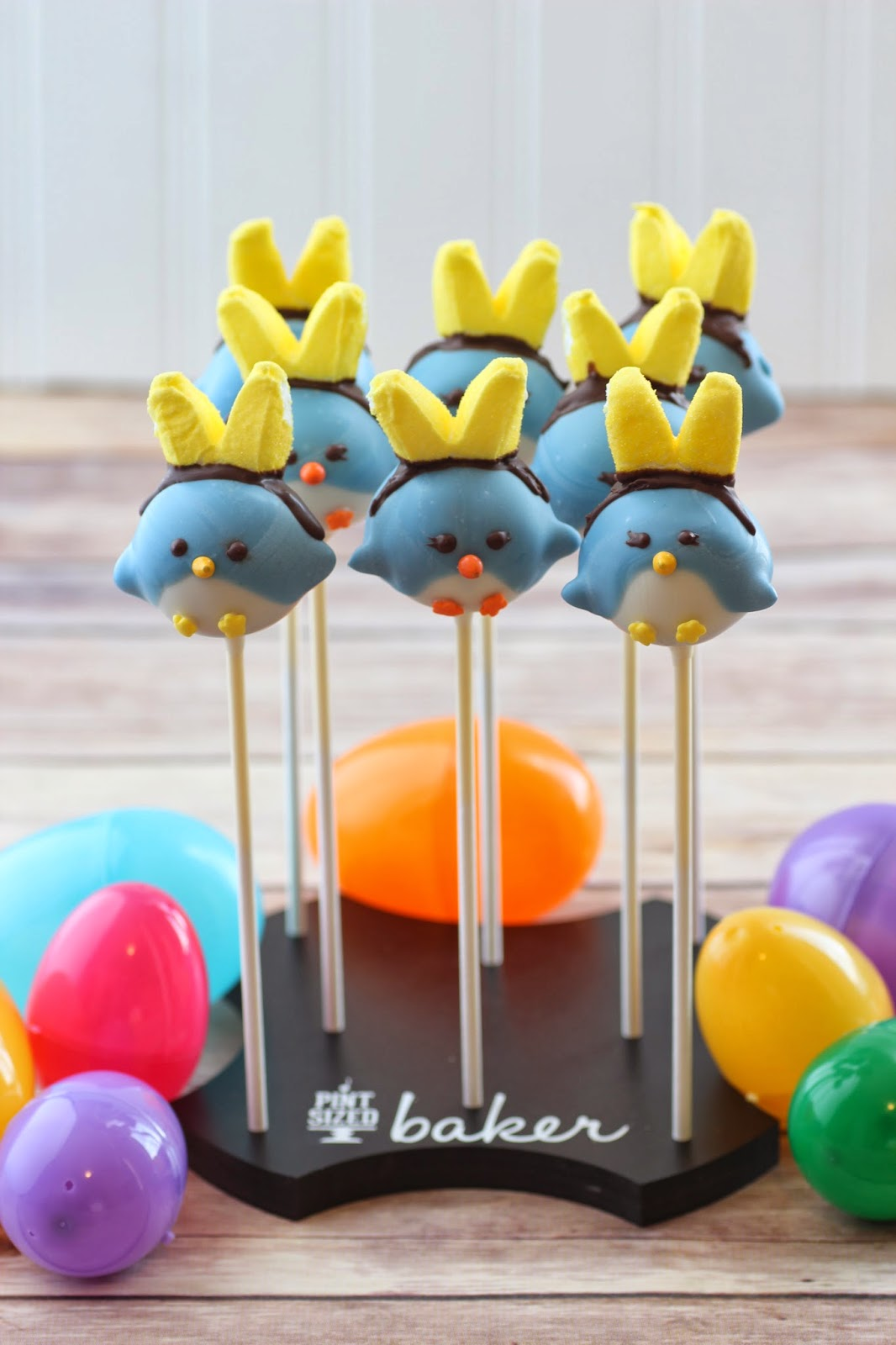 Spring Birdies with Bunny ears in a personalized Cake Pop Stand Co. stand. from @pintsizedbaker