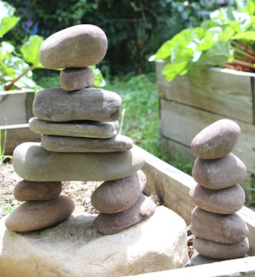 stacked stones in a garden