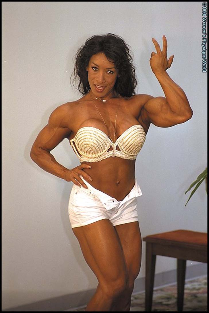 Denise Masino Flexing Her Bicep And Posing Her Muscular Physique