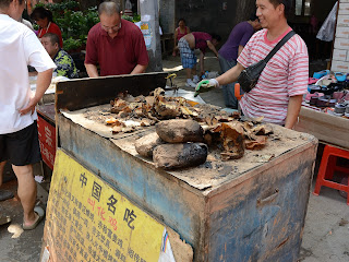 Beggars chicken or jiao hua ji for sale at the Fahaisi street market in Beijing
