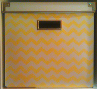 painting IKEA paper cardboard boxes with yellow chevron