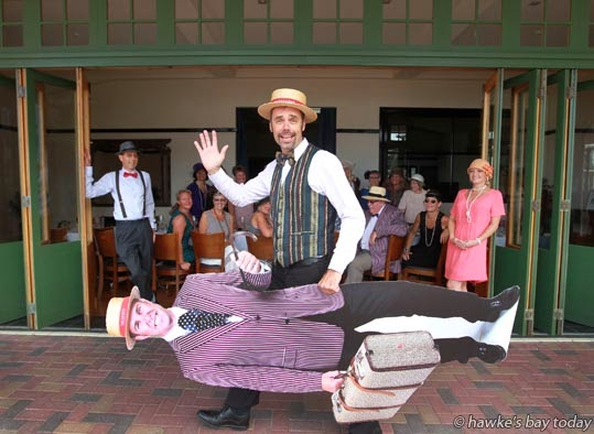 Stu Christensen, sales manager, Tremains, bringing a cut-out of Simon Tremain to a staff lunch at the Masonic Hotel, Marine Parade, Napier photograph