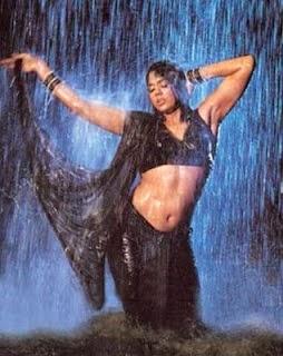 Sameera Reddy showing hot navel in rain