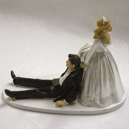 http://www.tiptopweddingshop.co.uk/products/Bride_Dragging_Groom_Cake_Topper-6370-0.html#.U3THTXazwis
