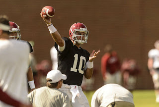 A.J. McCarron bruised his foot in fall practice.