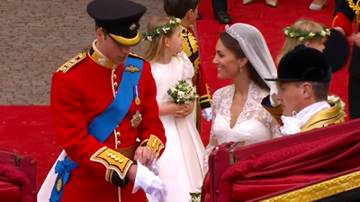 Prince William puts on gloves to board the carriage. YouTube 2011.