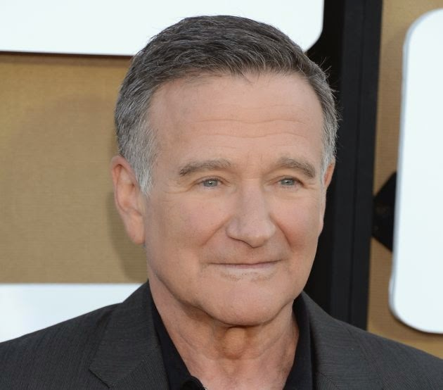 http://www.biography.com/news/robin-williams-dies-at-63