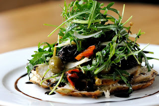 Chicken Paillard Salad, roasted tomatoes, black olives, capers