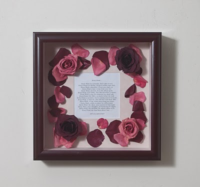Engagement poem with roses, petals and poem he wrote.