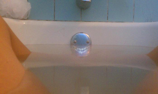 scary face in tub