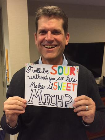 Jim Harbaugh uses high school prospect's own prom request sign in recruiting process.
