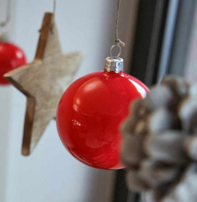 Coral Christmas baubles with wooden stars and cones