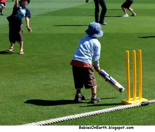 BABY CRICKET PLAYER