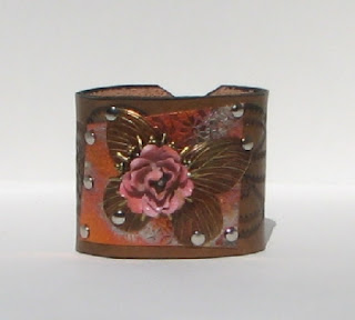 Butterfly on leather bracelet