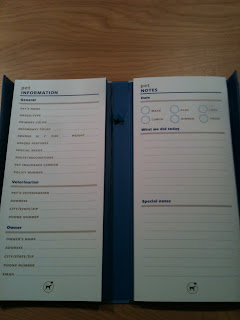 a book about the size of a shopping list pad, with spaces to write your pets information