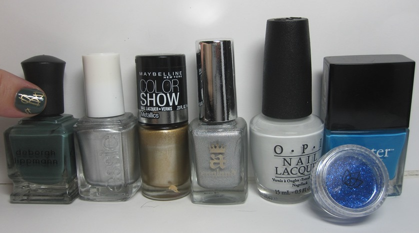 Bottle shot:  Deborah Lippmann Hannah, Essie No Place Like Chrome, Maybelline Bold Gold, A-England Encore Margot, OPI My Boyfriend Scales Walls, Butter London Keks, and glitter from Julep.