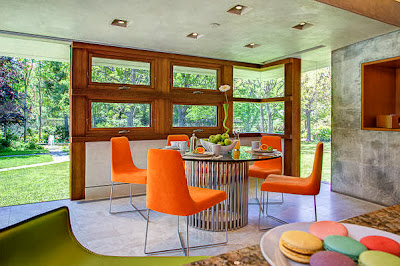 vibrant dining room design with plenty of windows