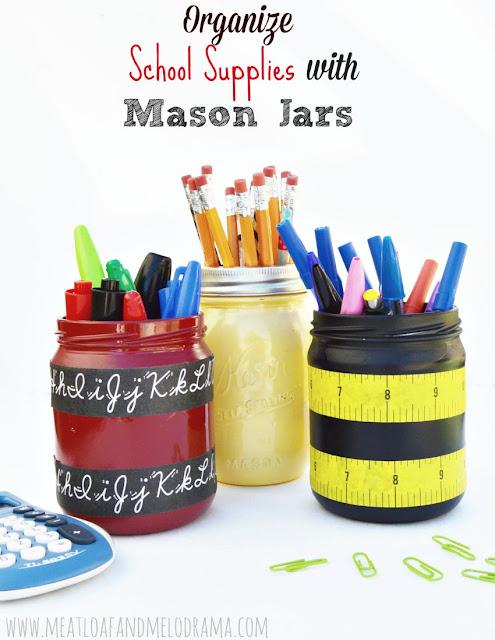 painted mason jars holding pens pencils and scissors