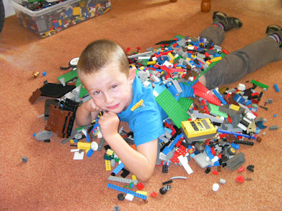 boy with lego collection