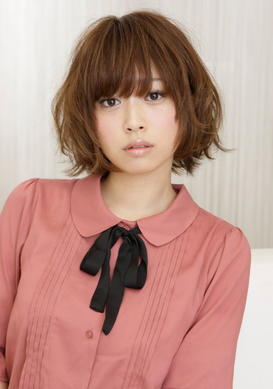 Short Japanese bob hairstyle 2012: layered short cut with bangs.