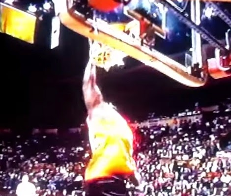 WWE Mark Henry dunking a basketball
