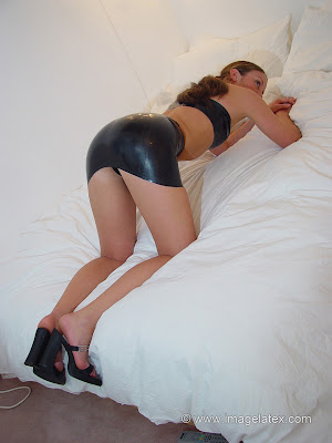 Talia Ass in the Air in black latex mini skirt