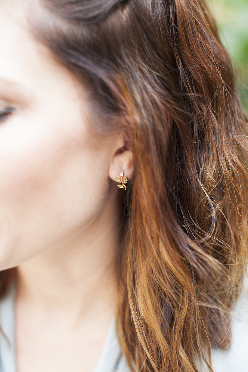 Amy West in earrings from Anthropologie