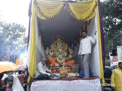 A Huge Ganpati idol being brought for visarjan in a truck