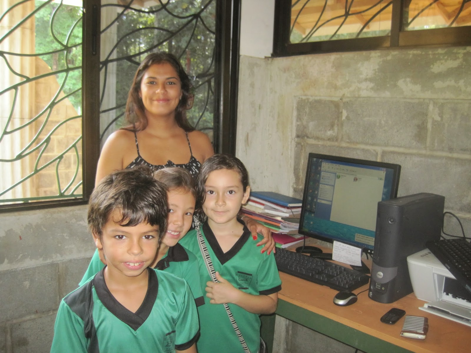 Donated PC with office manager and students