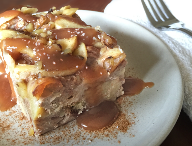 Apple bread pudding served warm and drizzled with salted caramel sauce