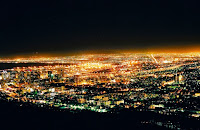 City lights of Cape Town, South Africa, powered by Eskom electric utility. (Credit: Martie Swart/flickr) Click to Enlarge.