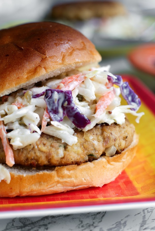 This Tuna Cake recipe transforms canned tuna into gorgeous golden tuna patties that are served alongside a lightened-up tartar sauce inspired cole slaw.  Pile it all on a bun to make a tasty tuna burger!