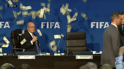 Protester Make It Rain on FIFA President Sepp Blatter During A Press Conference