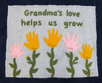 Grandma's Love Helps Us Grow wall hanging