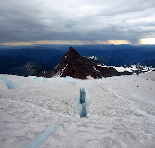A crevasse, Little Tahoma Peak, and Ingraham Flats.
