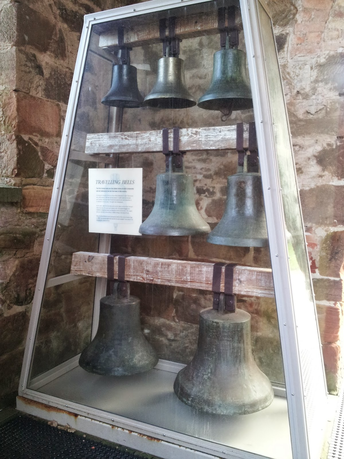 8 bells in a display case at Port Arthur