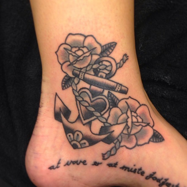 Old school flowers and anchor ankle tattoo