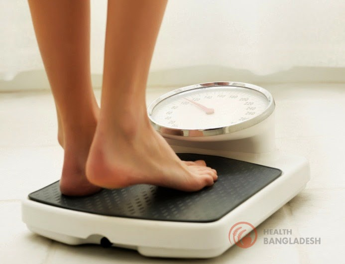 Girls stand on Body Weight measure device