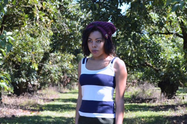 Fashion Blogger Anais Alexandre of Down to Stars in an American Apparel striped tank, vintage olive green suede skirt, and burgundy beanie in an avocado orchard