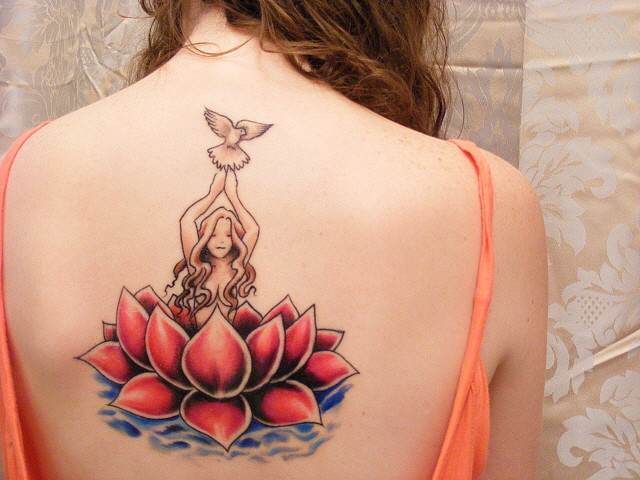 tattoos for girls on shoulders and back.  tattoo lotus flower, usually located in the back, shoulders,