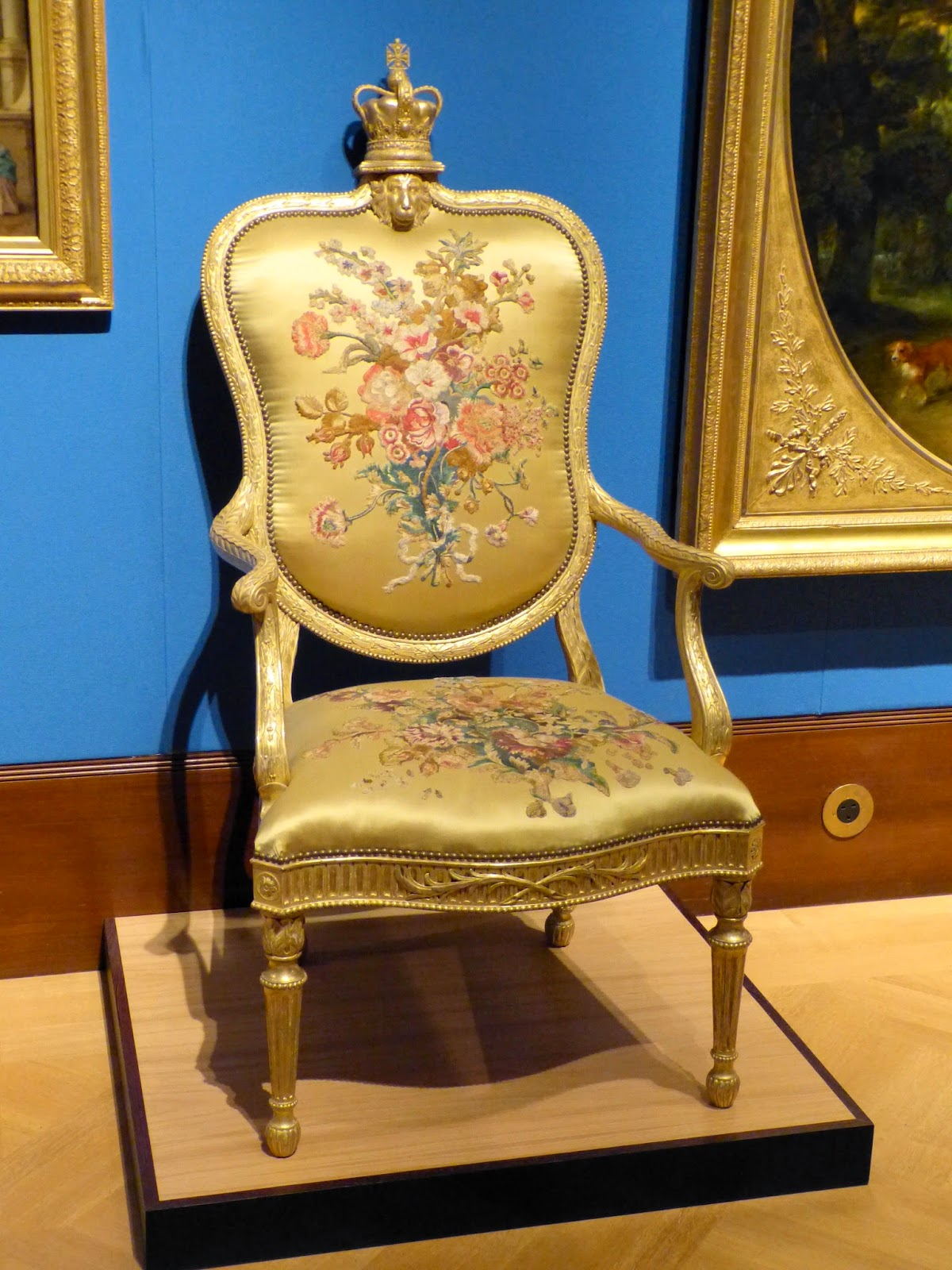 One of a pair of armchairs embroidered with designs  by Mary Moser attributed to the Royal School for   Embroidering Females under Mrs Nancy Pawsey (c1780)  Chair attributed to Robert Campbell