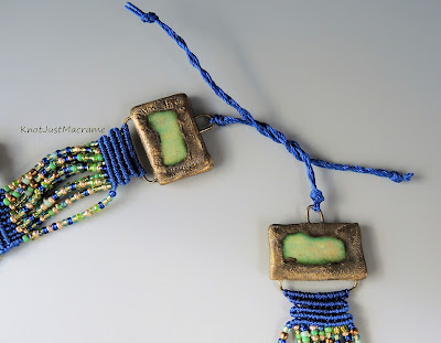 Ends of macrame necklace featuring ceramic pieces from Scorched Earth.