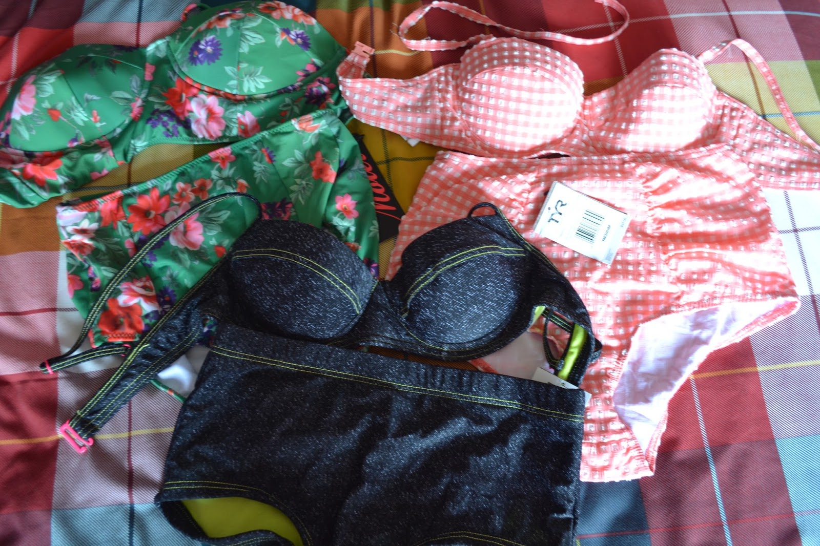 3 bikinis: pink gingham, faux denim and green tropical print