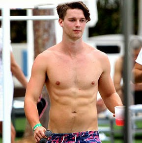Patrick Schwarzenegger shows off his six pack abs while going shirtless