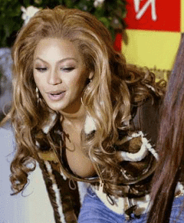 funniest pictures of celebrities: tits falling out of Beyonce