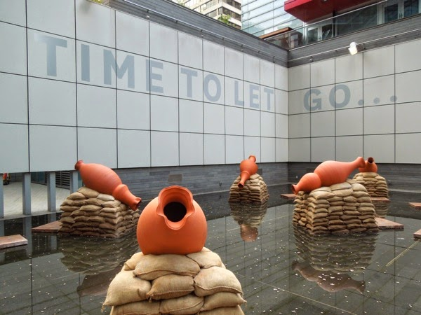 Time to Let Go terracotta pots art installation Vancouver