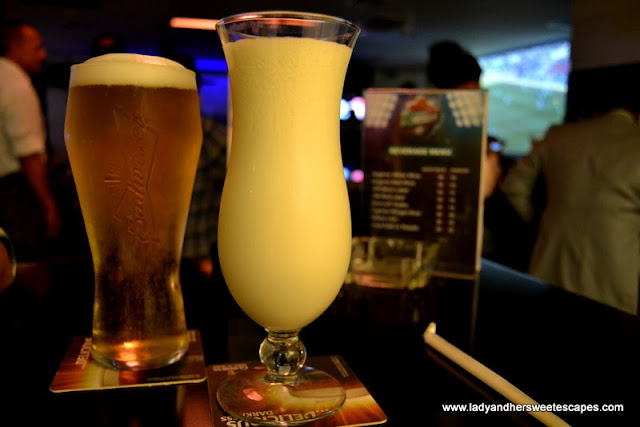 budweiser and colada mocktail at The Huddle Sports Bar And Grill in Citymax Hotel Burd Dubai
