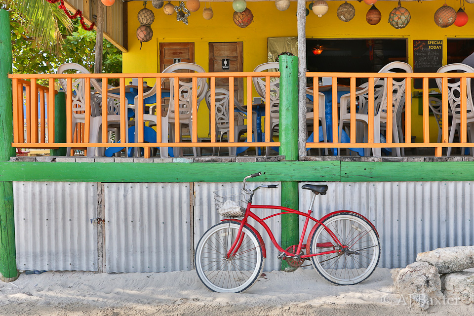 urban landscape image: Red Bike at Wild Mangos, San Pedro, Ambergris Caye, Belize
