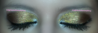 New Year's Eve mixed metals graphic eyeliner eye look, both eyes closed